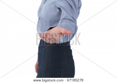 Businesswoman presenting with hand on white background