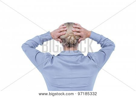 Rear view of worried businesswoman holding her head on white background