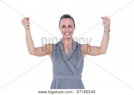 Businesswoman gesturing with raised arms on a white background