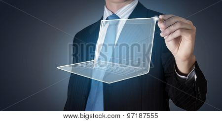 Close up of businessman drawing laptop on media screen