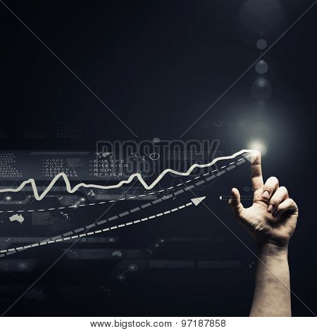 Human hand pressing icon of growing income chart