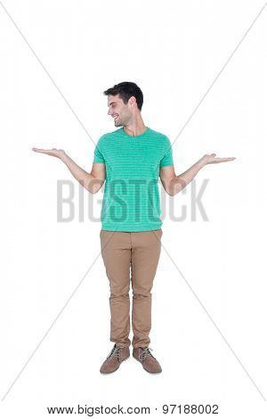 Handsome man showing something with his hands on white background
