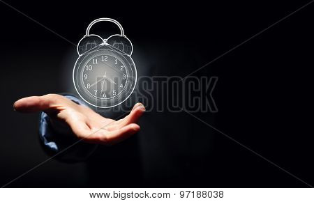 Close up of businessman hand showing clock watch symbol