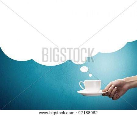 Hand holding coffee cup with speech bubble