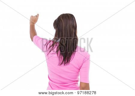Rear view of pretty brunette pointing something on white background
