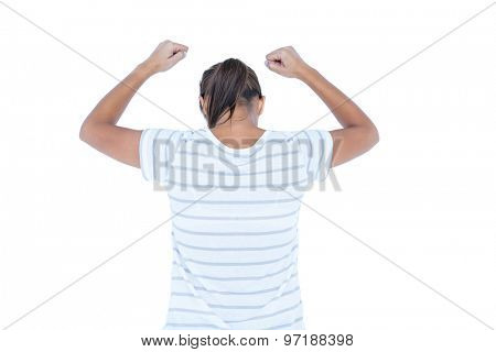 Wear view of brunette with arms up on white background