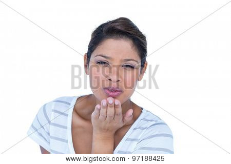 Pretty brunette blowing kisses on white background