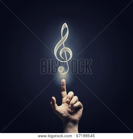Male hand choosing music note symbol from media icons
