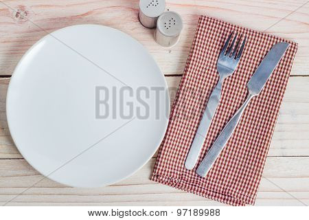 White Plate And Silverware On Table