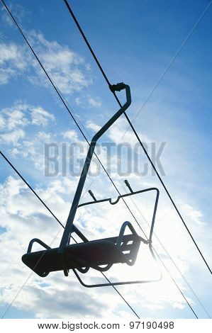 Chairlift seat and blue sky