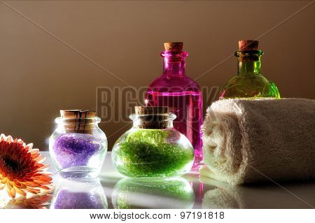 Oils And Bath Salts On White Glass Table Dimly Light