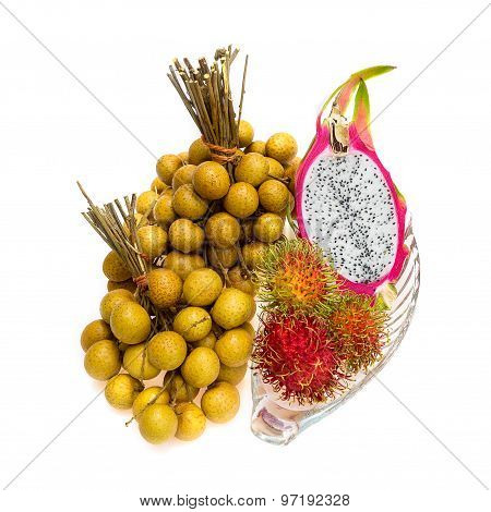 Longans, dragon fruit and rambutan on white