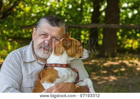 Bearded senior man with his cute dog