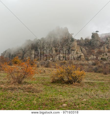 Autumnal landscape in Valley of Ghosts when fog falls from the mountain