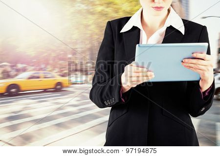 Redhead businesswoman using her tablet pc against new york street