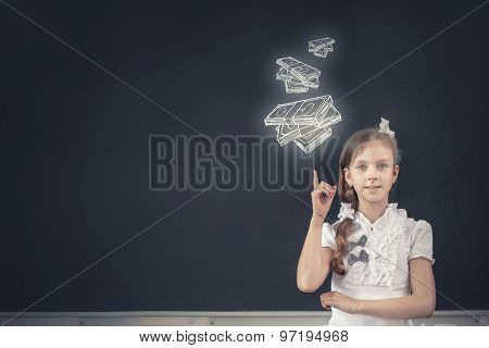 Cute school girl and drawn money banknotes on blackboard