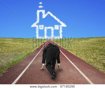 Businessman Ready To Race On Running Track Toward House Clouds