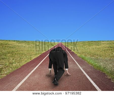 Businessman Ready To Race On Running Track