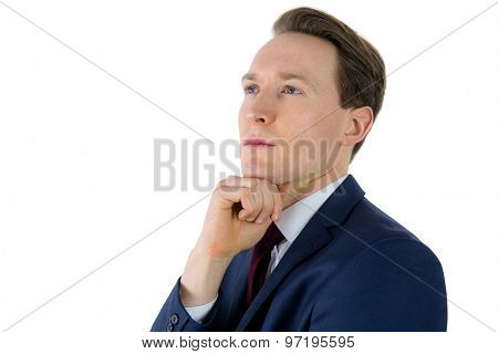 Thoughtful businessman looking away with hand on chin on white background
