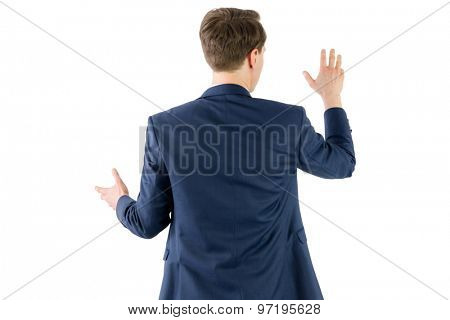 Wear view of businessman showing his hand on white background