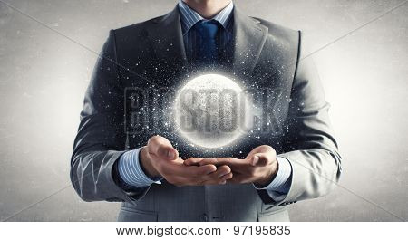 Close up of businessman holding moon planet in palms