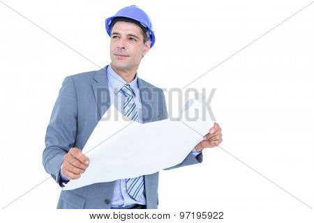 Businessman looking looking at a blueprint in a office