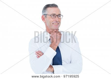 Thinking businessman standing with hand on chin against a white screen