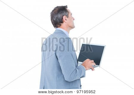excited cheering businessman sitting using his laptop against a white screen
