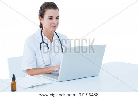 Doctor working on her laptop on a white screen