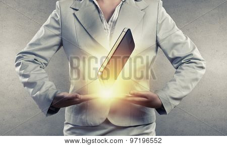 Close up of businesswoman presenting mobile phone