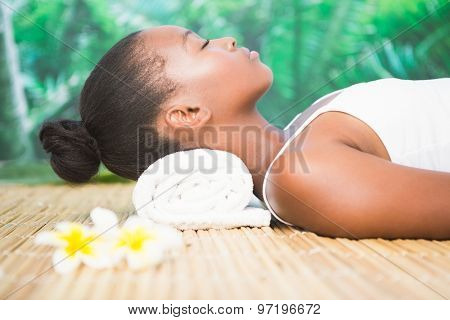 Side view of a beautiful young woman on massage table at spa center