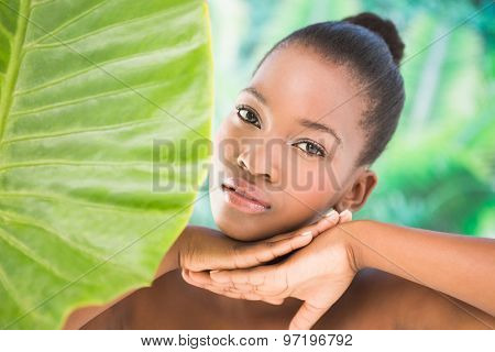 Close up view of a beautiful young woman over greenness background