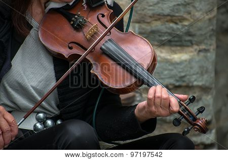 Woman Playing Violin On The Street. Unrecognizable Person.