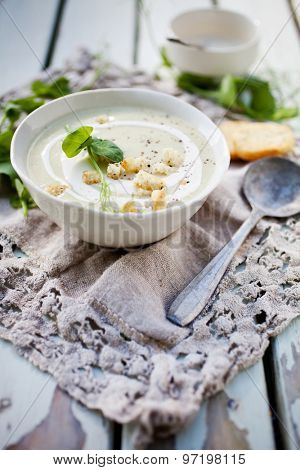 Homemade cauliflower soup with peas