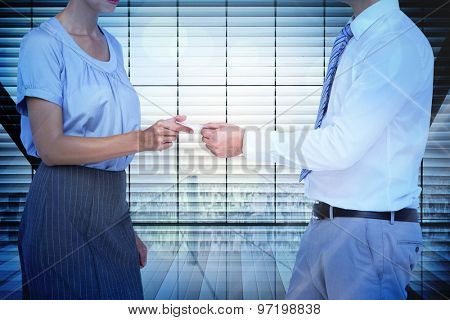 Business people exchanging business card against window overlooking city