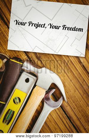 The word your project, your freedom and digital tablet displaying blueprint against white card