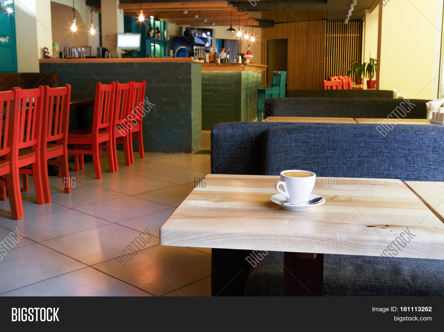 table with coffee cup in modern restaurant or cafe interior