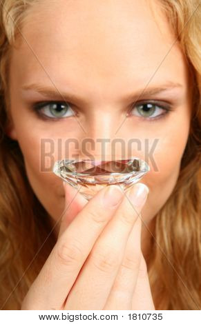 High Dof Image Of A Woman Holding A Large Round Diamond