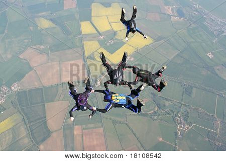 Five skydivers in freefall