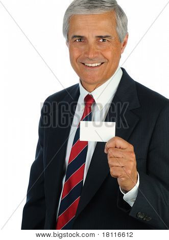 Portrait of a smiling middle aged business man holding a blank business card in front of his body. Vertical format isolated on white.