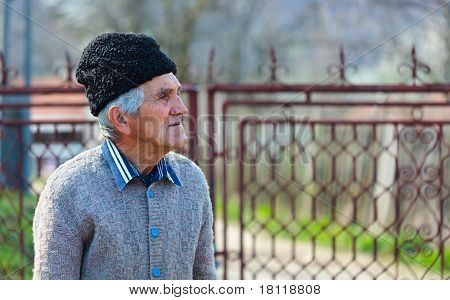 Old Man Near A Gate