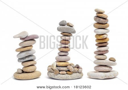 some piles of zen stones on a white background