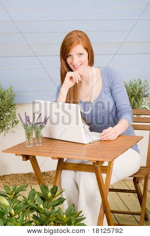 Portrait Redhead Woman With Laptop On Terrace