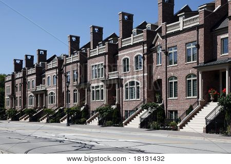 Row of brick townhomes with steps to entry