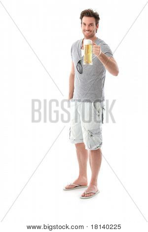 Happy young man drinking beer, holding beer mug, smiling.?