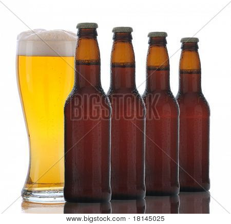 Four Beer bottles in a row with a full glass of ale behind front bottle. Isolated on a white background