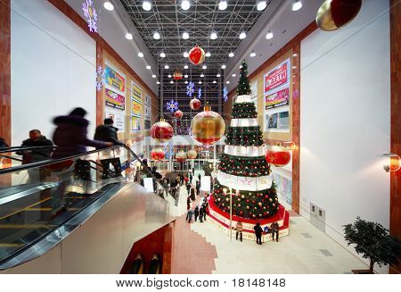 "MOSCOW, RUSSIA - JANUARY 16: Christmas tree in center of hall inside shopping mall ""Golden Babylon"" on January 16, 2010 in Russia, Moscow. In 2003, it was voted the best shopping center in Russia."
