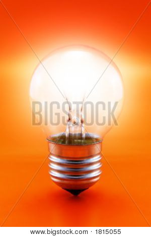Glowing Bulb On Red