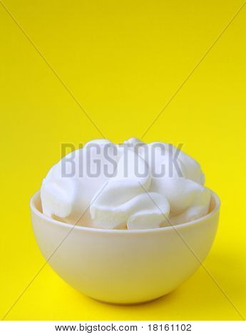 ice cream in a white cup on yellow background