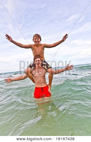 Brothers Have Fun In The Beautiful Clear Sea